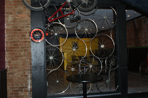OTB (Over the Bar) Bicycle Cafe, South Side, custom wheel wall